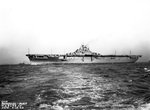 Portside broadside view of USS Yorktown (Essex-class) at Newport News, Virginia, United States, on her way to her commissioning ceremonies at Norfolk Navy Yard, 15 Apr 1943