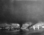 Strike photo of Manila Bay 5 Nov 1944 showing thick pall of smoke. Taken from aircraft from Bombing Squadron 80 flying from the USS Ticonderoga.