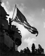 Battle Flag (larger flag) hoisted on the aircraft carrier Ticonderoga on orders issued throughout the fleet from Third Fleet Commander William Halsey in response to news that Japan had surrendered, 15 Aug 1945