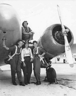 Four WASP pilots in front of a Cessna UC-78 Bobcat aircraft at Greenville AAF, Greenville, Mississippi, United States, Aug 1944. Deanie Bishop on the wing with Joan C Hutton, Emily Porter, and Phyllis M Johnson.