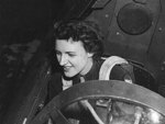 WASP pilot Lillian Yonally seated in the cockpit of an A-25A Shrike at Camp Irwin airstrip, California, United States, 1944