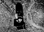 Bomb bay camera in a TBF-1 Avenger from USS Essex captures the moment of bomb release over the Pasig River in downtown Manila, Luzon, Philippines, 14 Nov 1944. Attack was on the dock area 2,000 yards further ahead.