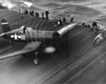 F4U Corsair of Marine Fighting Squadron VMF-124 on the flight deck of USS Essex, 25 Jan 1945.