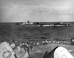 USS Hornet (Essex-class), distance, steaming with USS Langley (Independence-class) and USS Enterprise on their way back to Ulithi Atoll in the Caroline Islands, 25 Jan 1945.
