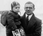 Nicholas Winton holding a child, probably in Prague, Czechoslovakia, probably in 1938.