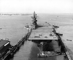USS Intrepid entering the deperming station at Norfolk, Virginia, United States, 11 Sep 1943. Note the outline of the ship's waterline painted on the flight deck. Photo 1 of 3.