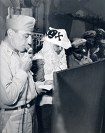 Captain Thomas L Sprague of the USS Intrepid offering remarks of welcome to he Ruler of the Raging Main, Neptunus Rex, and his escort just before for the Line Crossing ceremonies, 22 Jan 1944.