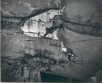 Looking up into a torpedo hole in the USS Intrepid hull 15 feet below the waterline near the starboard rudder, taken in Pearl Harbor Drydock #1, 26 Feb 1944. The damage was done 17 Feb 1944 off Truk.