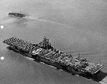 USS Intrepid departing San Francisco, California, 9 Jun 1944 packed with vehicles, equipment, and aircraft including SBD Dauntless, F6F Hellcats, C-45 Expeditors, PV-1 Venturas, and P-61 Black Widows. Photo 2 of 3