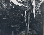 Damage to the flight deck and the hangar deck of USS Intrepid following the crash of a Japanese special attack aircraft off the Philippines, 25 Nov 1944