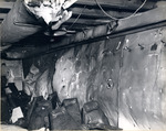 Bulging bulkhead in No. 3 Ready Room on the gallery deck of USS Intrepid from the explosion of a Japanese special attack aircraft in the hangar deck spaces, off the Philippines, 25 Nov 1944