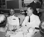 President Franklin Roosevelt, right, at lunch with Rear Admiral Alfred E Montgomery, commanding officer of Naval Air Station Corpus Christi, Texas, United States, 21 Apr 1943.