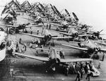 F6F-5 Hellcats being prepared for take-off aboard the carrier Franklin off Luzon, Philippine Islands, Oct 1944. Note SB2C Helldivers spotted aft.