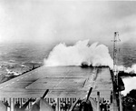 USS Hornet (Essex-class) taking white water over the bow in heavy seas off Okinawa, 5 Jun 1945. Hornet would soon take green water over the bow that collapsed the forward 24 feet of her flight deck.