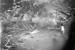 Carrier aircraft of US 3rd Fleet planes attacking battleship Haruna, Kure, Japan 28 Jul 1945; photo taken by aircraft from USS Wasp (Essex-class)
