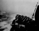 USS Wasp (Essex-class) rolls in heavy sea as the ship steamed into a typhoon south of Japan, 25 Aug 1945.