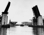 Essex-class Aircraft Carrier Hancock moving past the Fore River Bridge, Quincy, Massachusetts, United States, 14 Apr 1944, the day before her commissioning. Photo 1 of 2