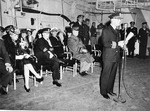 Captain Fred C Dickey taking command at the commissioning of USS Hancock, Navy Yard Annex, South Boston, 15 Apr 1944. Note Commandant First Naval District RearAdm Robert Theobald seated behind Dickey.