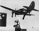 SB2C Helldiver of Bombing Squadron VB-7 coming aboard USS Hancock off the United States east coast, mid-1944