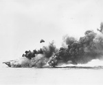 USS Hancock maneuvering to control fires after being hit by a Japanese special attack aircraft off Okinawa, Japan, 7 Apr 1945