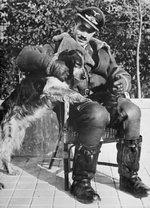 Adolf Galland in his flying gear with his dog, 'Schweinebauch' (Pork Belly), Audembert, France 1940.