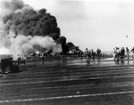 Fantail of USS Belleau Wood burning after being struck by a special attack aircraft, off the Philippine Islands, 30 Oct 1944