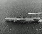 Essex-class carrier USS Bon Homme Richard cruising in the Gulf of Paria between Trinidad and Venezuela on her shakedown cruise, 7 Feb 1945. Note TBM Avenger on her deck and Coast Guard guard boat alongside