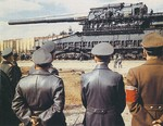 "Adolf Hitler, second from right, Albert Speer, right, and others, at the Rügenwalde testing grounds in Pomerania (now Darłowo, Poland) on 19 Mar 1943 to see the giant 800mm railway gun ""Dora,"" sister gun to the ""Gustav."""