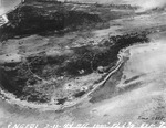 Strike photo stitched together from photos taken by USS Langley aircraft showing severe damage to the runway and the surrounding areas on Engebi Island (now Enjebi), Eniwetok Atoll, Marshall Islands, 11 Feb 1944.