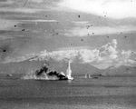 A water plume from a torpedo striking against the bow of super-battleship Musashi rises high in the air during the Battle of the Sibuyan Sea, 24 Oct 1944