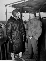 Captain Walton Smith of the Independence-class carrier USS Cabot on the bridge with war correspondent Ernie Pyle off Japan, Feb 1945. Note inscription by Pyle.