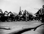 F6F Hellcats of Fighting Squadron VF-45 aboard Independence-class carrier USS San Jacinto off Kyushu, Japan, 18 Mar 1945. Note the open gun access panels in the fighters' wings.