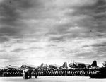 Training Squadron 17 lining up for their graduation photo at the Naval Air Station at Corpus Christi, Texas, United States, circa 1942. Note OS2U Kingfisher aircraft.