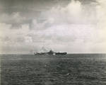 Carrier USS Bunker Hill taking a near miss from a Japanese dive bomber close aboard the starboard quarter, 19 Jun 1944 off Guam, Mariana Islands. The ship was not damaged. Photo 2 of 2