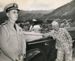 While touring Oahu, US Territory of Hawaii, President Franklin Roosevelt (seated in car) listened to Col William Saffarans (in jungle suit) at the Army's Jungle Training Unit at Kahana Bay, 28 July 1944.
