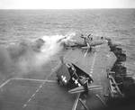 Following an attack from Japanese special attack aircraft, fires grew in the forward hangar deck of USS Saratoga off Iwo Jima, 21 Feb 1945. The fires increased greatly before they could be controlled. Photo 1 of 3