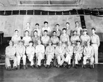 Vice Admiral Marc Mitscher (front row center) and his Fifth Fleet staff photographed on the hangar deck of USS Enterprise on the occasion of coming aboard, 11 May 1945. Note Commodore Arleigh Burke next to Mitscher.