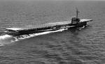Training carrier USS Sable underway on Lake Michigan, United States, Jun 1945. Note the side-wheel propulsion.