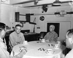 Admiral Halsey, Rear Admiral Charles P Mason, Captain Austin K Doyle, and an unidentified captain in the captain