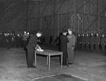 Commodore Leslie Gehres standing at attention while Vice Admiral Jack Fletcher presents him with the Legion of Merit award, Adak, Alaska, 19 Jan 1944. Photo 1 of 2.