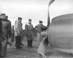 Commodore Leslie Gehres inspecting a PV-1 Ventura of Bombing Squadron VB-139 after a belly landing on Attu Island, Alaska, 18 May 1944. Note the Marsden Matting runway surface