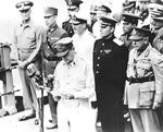 Chester Nimitz, Xu Yongchang, Bruce Fraser, Kuzma Derevyanko, and Thomas Blamey behind Douglas MacArthur aboard USS Missouri during the surrender ceremony, Tokyo Bay, Japan, 2 Sep 1945.