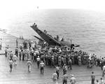 The USS Enterprise conducted flight training when steaming from Hawaii to Tonga on 23 Jul 1942. Here, upon landing, a TBF Avenger slid off the flight deck into the catwalks; no injuries.