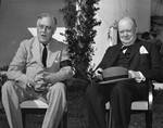 Franklin Roosevelt and Winston Churchill pose for photographs in the gardens of Roosevelt?s Villa Dar es Saada in the Anfa neighborhood of Casablanca, French Morocco during the Casablanca Conference, 24 Jan 1943.