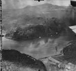 Strike photo taken from planes flying from USS Bunker Hill of Japanese Destroyer Escorts after being attacked in Unten Harbor, Okinawa, Japan, 10 Oct 1944