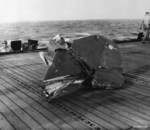 Tail section of a D4Y Suisei 'Judy' dive bomber that landed on the flight deck of Escort Carrier USS Kitkun Bay after being exploded in flight by intense anti-aircraft fire during the Battle off Samar, 25 Oct 1944