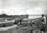 LSTs and LCVPs unloading men, equipment, and provisions on White Beach Two in Lingayen Gulf, Luzon, Philippine Islands, 9 Jan 1945.