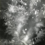Strike photo taken by US carrier planes during an air attack on Kure Naval Arsenal, Hiroshima, Japan, Jul 1945. Note anti-aircraft bursts and screening smoke in addition to bomb impacts.