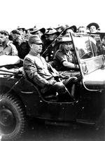 An Australian soldier driving Japanese Lieutenant General Hatazo Adachi to the Wom Airstrip, New Guinea for the formal New Guinea surrender ceremony, 13 Sep 1945