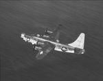 PB4Y-2 Privateer (derived from the PB4Y-1 Liberator) in flight off the eastern shore of Oahu, Hawaii, 1945. Photo 1 of 3.